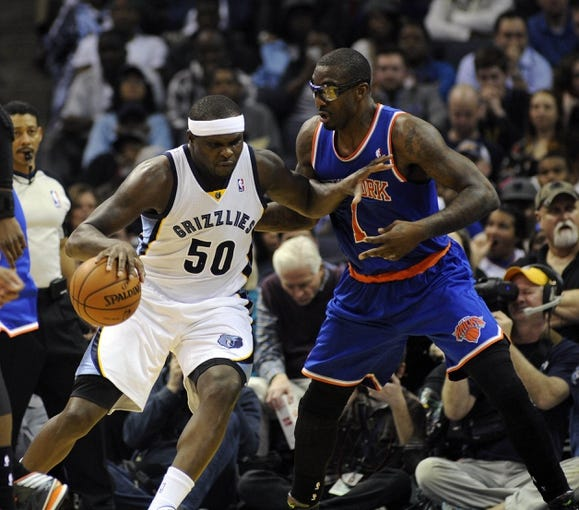 Feb 18, 2014; Memphis, TN, USA; Memphis Grizzlies power forward Zach Randolph (50) posts up against New York Knicks power forward Amar'e Stoudemire (1) during the game at FedExForum. Memphis Grizzlies beat New York Knicks 98 - 93. Mandatory Credit: Justin Ford-USA TODAY Sports