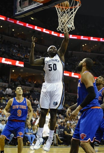 Feb 18, 2014; Memphis, TN, USA; Memphis Grizzlies power forward Zach Randolph (50) lays the ball up against New York Knicks center Tyson Chandler (6) during the game at FedExForum. Memphis Grizzlies beat New York Knicks 98 - 93. Mandatory Credit: Justin Ford-USA TODAY Sports