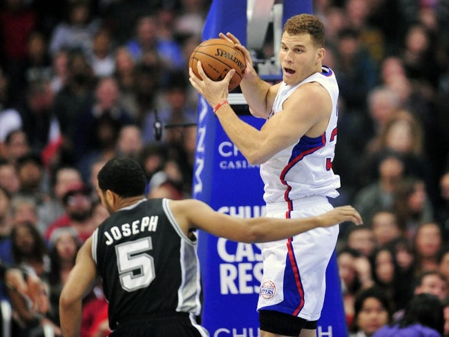 February 18, 2014; Los Angeles, CA, USA; Los Angeles Clippers power forward Blake Griffin (32) grabs a rebound against the San Antonio Spurs during the first half at Staples Center. Mandatory Credit: Gary A. Vasquez-USA TODAY Sports