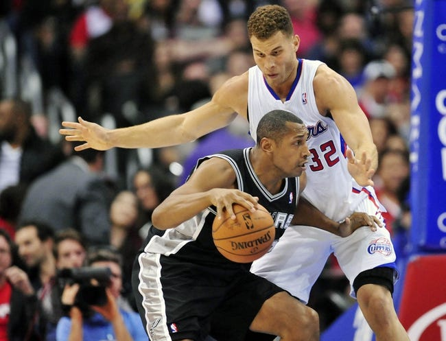 February 18, 2014; Los Angeles, CA, USA; San Antonio Spurs power forward Boris Diaw (33) moves the ball against Los Angeles Clippers power forward Blake Griffin (32) during the first half at Staples Center. Mandatory Credit: Gary A. Vasquez-USA TODAY Sports