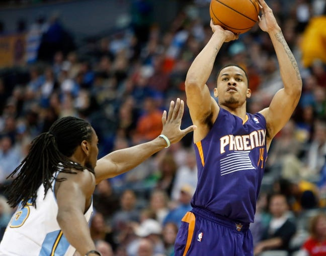 Feb 18, 2014; Denver, CO, USA; Phoenix Suns guard Gerald Green (14) shoots the ball during the second half against the Denver Nuggets at Pepsi Center.  The Suns won 112-107 in overtime.  Mandatory Credit: Chris Humphreys-USA TODAY Sports