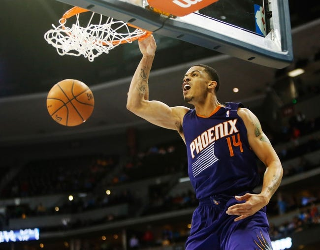 Feb 18, 2014; Denver, CO, USA; Phoenix Suns guard Gerald Green (14) dunks the ball during the overtime period against the Denver Nuggets at Pepsi Center.  The Suns won 112-107 in overtime.  Mandatory Credit: Chris Humphreys-USA TODAY Sports