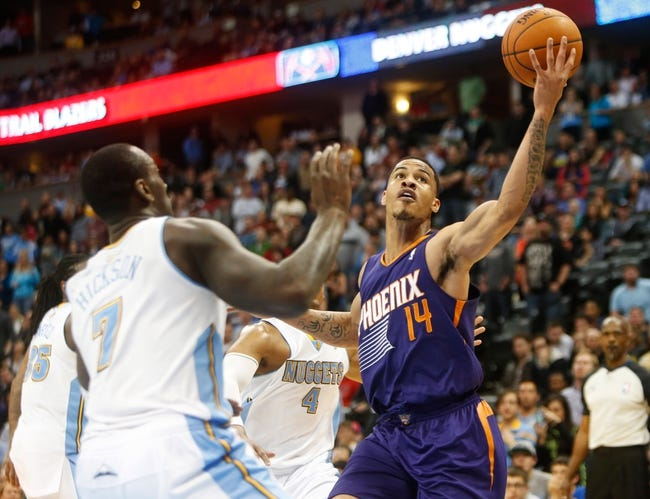 Feb 18, 2014; Denver, CO, USA; Phoenix Suns guard Gerald Green (14) shoots the ball during the overtime period against the Denver Nuggets at Pepsi Center.  The Suns won 112-107 in overtime.  Mandatory Credit: Chris Humphreys-USA TODAY Sports