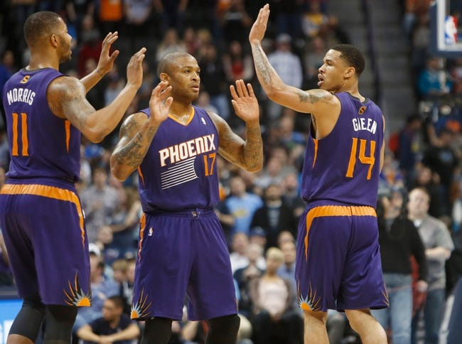 Feb 18, 2014; Denver, CO, USA; Phoenix Suns guard Gerald Green (14) celebrates with forward P.J. Tucker (17) and forward Markieff Morris (11) during the overtime period against the Denver Nuggets at Pepsi Center.  The Suns won 112-107 in overtime.  Mandatory Credit: Chris Humphreys-USA TODAY Sports