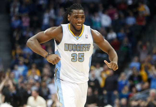 Feb 18, 2014; Denver, CO, USA; Denver Nuggets forward Kenneth Faried (35) reacts during the overtime period against the Phoenix Suns at Pepsi Center.  The Suns won 112-107 in overtime.  Mandatory Credit: Chris Humphreys-USA TODAY Sports