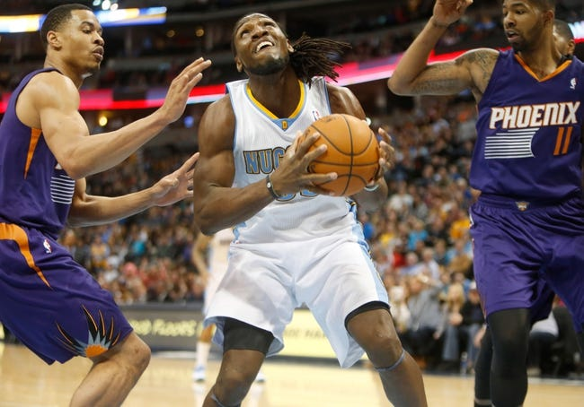 Feb 18, 2014; Denver, CO, USA; Denver Nuggets forward Kenneth Faried (35) looks to shoot the ball during the second half against the Phoenix Suns at Pepsi Center.  The Suns won 112-107 in overtime.  Mandatory Credit: Chris Humphreys-USA TODAY Sports