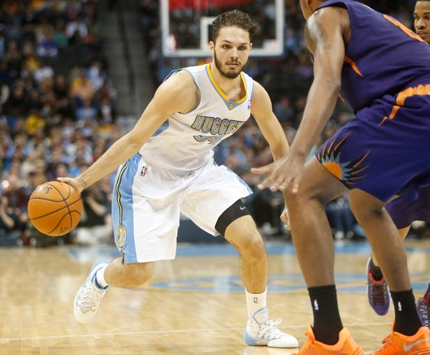 Feb 18, 2014; Denver, CO, USA; Denver Nuggets guard Evan Fournier (94) during the second half against the Phoenix Suns at Pepsi Center. The Suns won 112-107 in overtime.  Mandatory Credit: Chris Humphreys-USA TODAY Sports