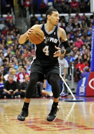 February 18, 2014; Los Angeles, CA, USA; San Antonio Spurs shooting guard Danny Green (4) controls the ball against the Los Angeles Clippers during the second half at Staples Center. Mandatory Credit: Gary A. Vasquez-USA TODAY Sports