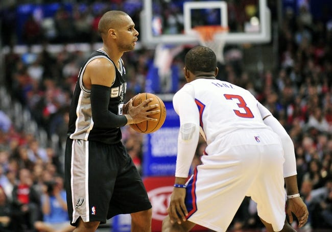 February 18, 2014; Los Angeles, CA, USA; San Antonio Spurs point guard Patty Mills (8) controls the ball against  Los Angeles Clippers point guard Chris Paul (3) during the second half at Staples Center. Mandatory Credit: Gary A. Vasquez-USA TODAY Sports
