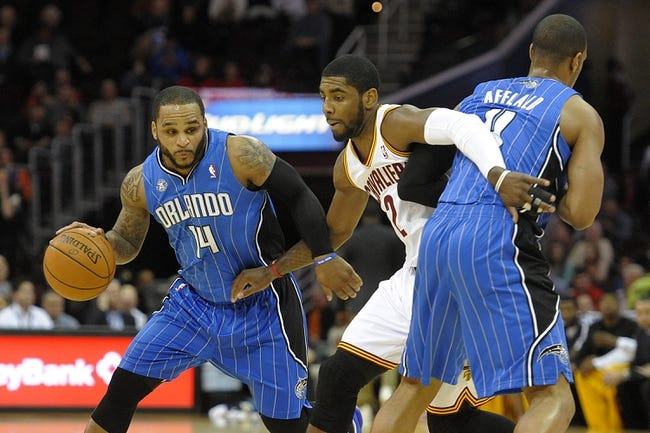 Feb 19, 2014; Cleveland, OH, USA; Orlando Magic point guard Jameer Nelson (14) dribbles against Cleveland Cavaliers point guard Kyrie Irving (2) in the first quarter at Quicken Loans Arena. Mandatory Credit: David Richard-USA TODAY Sports