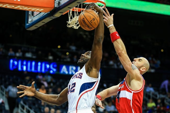 Feb 19, 2014; Atlanta, GA, USA; Atlanta Hawks power forward Elton Brand (42) and Washington Wizards center Marcin Gortat (4) attempts to grab a rebound in the first quarter at Philips Arena. Mandatory Credit: Daniel Shirey-USA TODAY Sports