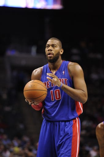Feb 19, 2014; Charlotte, NC, USA; Detroit Pistons forward center Tony Mitchell (10) prepares to shoot a foul shot during the first half of the game against the Charlotte Bobcats at Time Warner Cable Arena. Mandatory Credit: Sam Sharpe-USA TODAY Sports