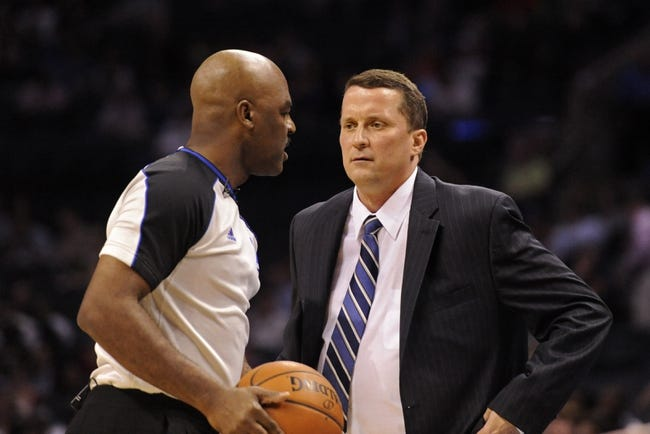 Feb 19, 2014; Charlotte, NC, USA; Detroit Pistons head coach John Loyer talks to the referee during the first half of the game against the Charlotte Bobcats at Time Warner Cable Arena. Mandatory Credit: Sam Sharpe-USA TODAY Sports
