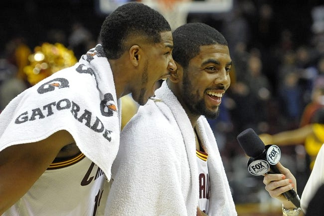 Feb 19, 2014; Cleveland, OH, USA; Cleveland Cavaliers power forward Tristan Thompson (left) celebrates with point guard Kyrie Irving (2) after a 101-93 win over the Orlando Magic at Quicken Loans Arena. Mandatory Credit: David Richard-USA TODAY Sports