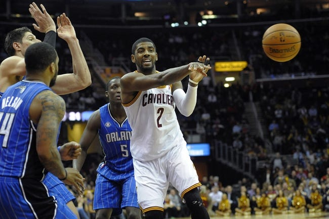 Feb 19, 2014; Cleveland, OH, USA; Cleveland Cavaliers point guard Kyrie Irving (2) passes in the fourth quarter against the Orlando Magic at Quicken Loans Arena. Mandatory Credit: David Richard-USA TODAY Sports