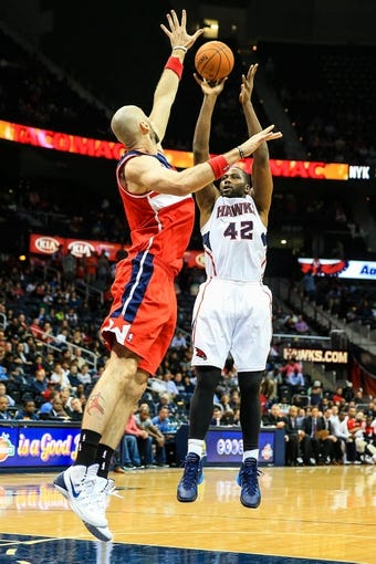 Feb 19, 2014; Atlanta, GA, USA; Atlanta Hawks power forward Elton Brand (42) shoots a basket over Washington Wizards center Marcin Gortat (4) in the second half at Philips Arena. The Wizards won 114-97. Mandatory Credit: Daniel Shirey-USA TODAY Sports