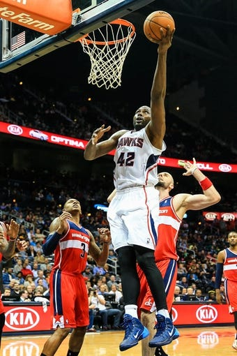 Feb 19, 2014; Atlanta, GA, USA; Atlanta Hawks power forward Elton Brand (42) shoots a basket in the second half against the Washington Wizards at Philips Arena. The Wizards won 114-97. Mandatory Credit: Daniel Shirey-USA TODAY Sports