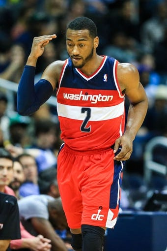Feb 19, 2014; Atlanta, GA, USA; Washington Wizards point guard John Wall (2) reacts to shooting a three in the second half against the Atlanta Hawks at Philips Arena. The Wizards won 114-97. Mandatory Credit: Daniel Shirey-USA TODAY Sports