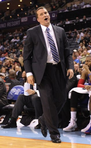 Feb 19, 2014; Charlotte, NC, USA; Detroit Pistons head coach John Loyer reacts during the second half of the game against the Charlotte Bobcats at Time Warner Cable Arena. Bobcats win 116-98. Mandatory Credit: Sam Sharpe-USA TODAY Sports