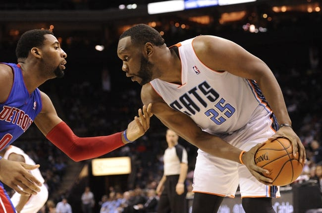 Feb 19, 2014; Charlotte, NC, USA; Charlotte Bobcats center Al Jefferson (25) looks to drive past Detroit Pistons center Andre Drummond (0) during the second half of the game at Time Warner Cable Arena. Bobcats win 116-98. Mandatory Credit: Sam Sharpe-USA TODAY Sports