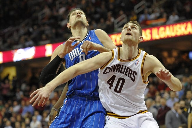 Feb 19, 2014; Cleveland, OH, USA; Cleveland Cavaliers center Tyler Zeller (40) and Orlando Magic center Nikola Vucevic (9) position for a rebound in the fourth quarter at Quicken Loans Arena. Mandatory Credit: David Richard-USA TODAY Sports