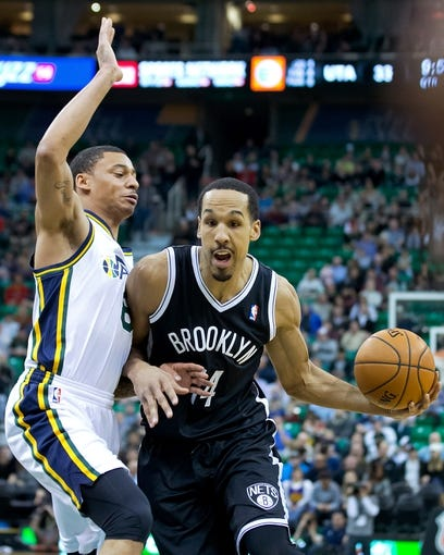 Feb 19, 2014; Salt Lake City, UT, USA; Utah Jazz point guard Diante Garrett (8) defends against Brooklyn Nets point guard Shaun Livingston (14) during the first half at EnergySolutions Arena. Mandatory Credit: Russ Isabella-USA TODAY Sports