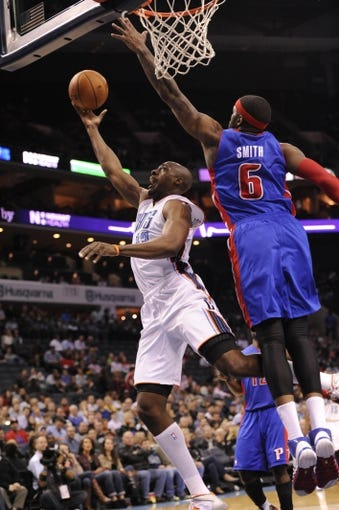 Feb 19, 2014; Charlotte, NC, USA; Charlotte Bobcats forward Anthony Tolliver (43) drives to the basket as he is defended by Detroit Pistons forward Josh Smith (6) during the second half of the game at Time Warner Cable Arena. Bobcats win 116-98. Mandatory Credit: Sam Sharpe-USA TODAY Sports