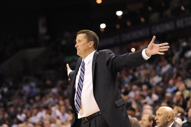 Feb 19, 2014; Charlotte, NC, USA; Detroit Pistons head coach John Loyer during the second half of the game against the Charlotte Bobcats at Time Warner Cable Arena. Bobcats win 116-98. Mandatory Credit: Sam Sharpe-USA TODAY Sports