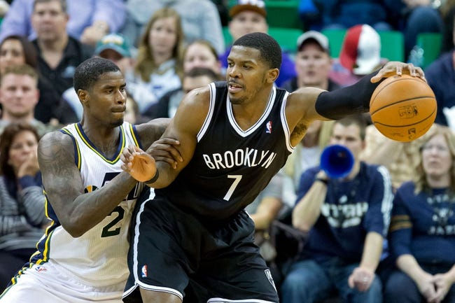 Feb 19, 2014; Salt Lake City, UT, USA; Utah Jazz power forward Marvin Williams (2) defends against Brooklyn Nets shooting guard Joe Johnson (7) during the second half at EnergySolutions Arena. The Nets won 105-99. Mandatory Credit: Russ Isabella-USA TODAY Sports