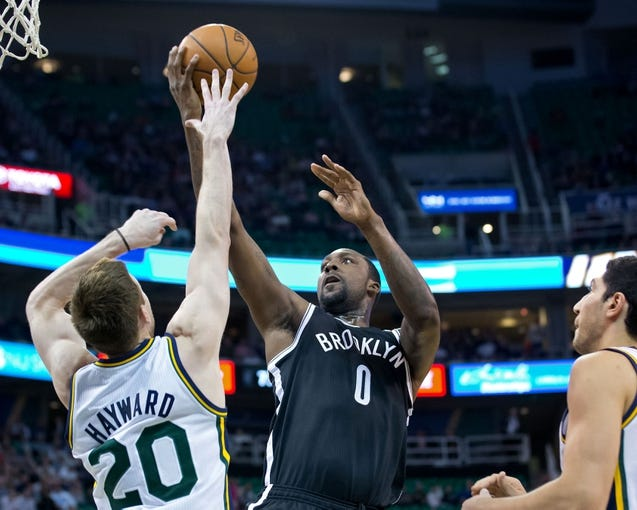 Feb 19, 2014; Salt Lake City, UT, USA; Brooklyn Nets center Andray Blatche (0) shoots over Utah Jazz shooting guard Gordon Hayward (20) during the first half at EnergySolutions Arena. The Nets won 105-99. Mandatory Credit: Russ Isabella-USA TODAY Sports