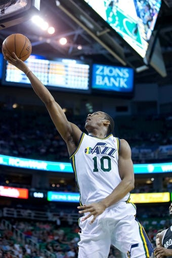 Feb 19, 2014; Salt Lake City, UT, USA; Utah Jazz point guard Alec Burks (10) goes to the basket during the second half against the Brooklyn Nets at EnergySolutions Arena. The Nets won 105-99. Mandatory Credit: Russ Isabella-USA TODAY Sports