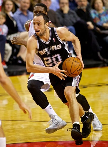 Feb 19, 2014; Portland, OR, USA; San Antonio Spurs shooting guard Manu Ginobili (20) moves to the basket against the Portland Trail Blazers during the third quarter at the Moda Center. Mandatory Credit: Craig Mitchelldyer-USA TODAY Sports