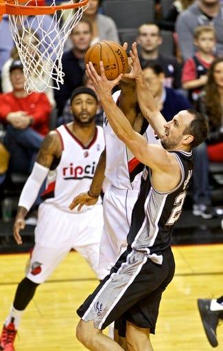 Feb 19, 2014; Portland, OR, USA; San Antonio Spurs shooting guard Manu Ginobili (20) shoots against the Portland Trail Blazers during the third quarter at the Moda Center. Mandatory Credit: Craig Mitchelldyer-USA TODAY Sports