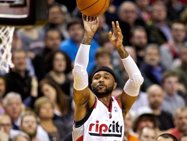 Feb 19, 2014; Portland, OR, USA; Portland Trail Blazers point guard Mo Williams (25) shoots over San Antonio Spurs center Jeff Ayres (11) during the first quarter at the Moda Center. Mandatory Credit: Craig Mitchelldyer-USA TODAY Sports
