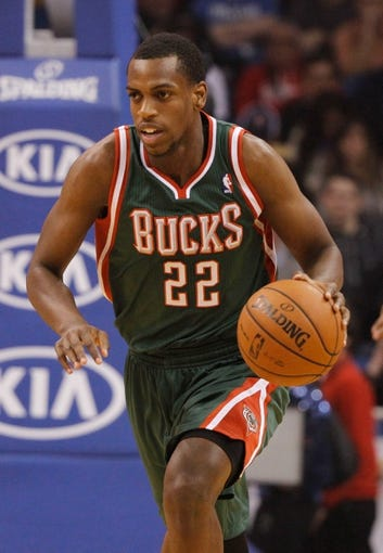 Jan 31, 2014; Orlando, FL, USA; Milwaukee Bucks power forward Khris Middleton (22) drives to the basket against the Orlando Magic during the first quarter at Amway Center. Mandatory Credit: Kim Klement-USA TODAY Sports