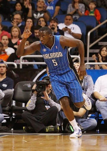 Jan 31, 2014; Orlando, FL, USA; Orlando Magic shooting guard Victor Oladipo (5) reacts after he dunks against the Milwaukee Bucks during the first quarter at Amway Center. Mandatory Credit: Kim Klement-USA TODAY Sports
