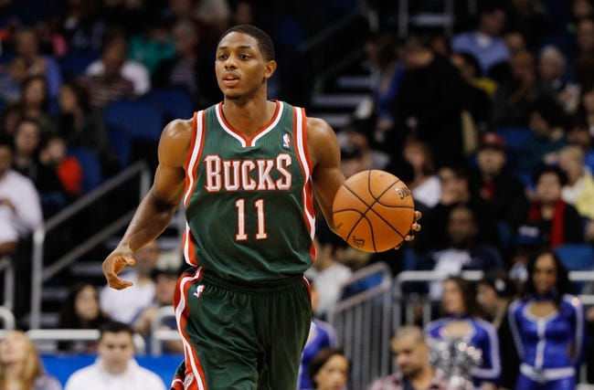 Jan 31, 2014; Orlando, FL, USA; Milwaukee Bucks point guard Brandon Knight (11) drives to the basket against the Orlando Magic during the second quarter at Amway Center. Mandatory Credit: Kim Klement-USA TODAY Sports