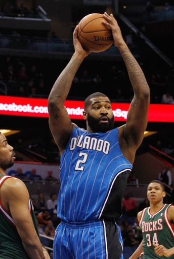 Jan 31, 2014; Orlando, FL, USA; Orlando Magic power forward Kyle O'Quinn (2) against the Milwaukee Bucks during the second half at Amway Center. Orlando Magic defeated the Milwaukee Bucks 113-102.  Mandatory Credit: Kim Klement-USA TODAY Sports
