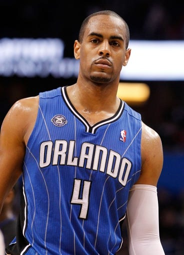 Jan 31, 2014; Orlando, FL, USA; Orlando Magic shooting guard Arron Afflalo (4) against the Milwaukee Bucks during the second half at Amway Center. Orlando Magic defeated the Milwaukee Bucks 113-102.  Mandatory Credit: Kim Klement-USA TODAY Sports