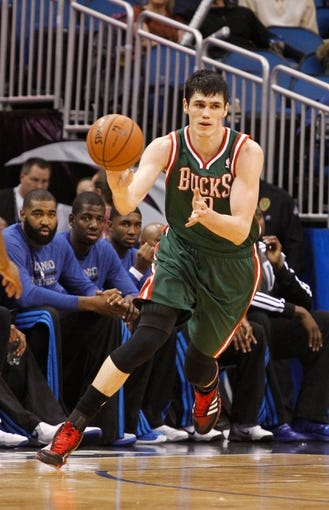 Jan 31, 2014; Orlando, FL, USA; Milwaukee Bucks power forward Ersan Ilyasova (7) against the Orlando Magic during the second half at Amway Center. Orlando Magic defeated the Milwaukee Bucks 113-102.  Mandatory Credit: Kim Klement-USA TODAY Sports