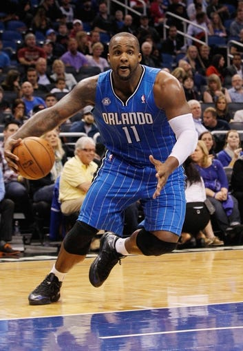 Jan 31, 2014; Orlando, FL, USA; Orlando Magic power forward Glen Davis (11) drives to the basket against the Milwaukee Bucks during the second half at Amway Center. Orlando Magic defeated the Milwaukee Bucks 113-102.  Mandatory Credit: Kim Klement-USA TODAY Sports