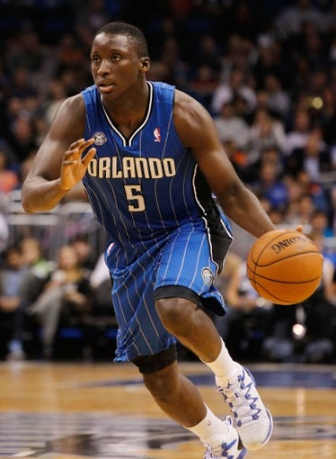 Jan 31, 2014; Orlando, FL, USA; Orlando Magic shooting guard Victor Oladipo (5) drives to the basket against the Milwaukee Bucks during the second half at Amway Center. Orlando Magic defeated the Milwaukee Bucks 113-102.  Mandatory Credit: Kim Klement-USA TODAY Sports