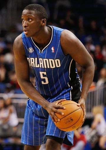 Jan 31, 2014; Orlando, FL, USA; Orlando Magic shooting guard Victor Oladipo (5) against the Milwaukee Bucks during the second half at Amway Center. Orlando Magic defeated the Milwaukee Bucks 113-102.  Mandatory Credit: Kim Klement-USA TODAY Sports