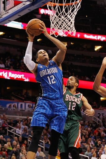 Jan 31, 2014; Orlando, FL, USA; Orlando Magic small forward Tobias Harris (12) shoots against the Milwaukee Bucks during the second half at Amway Center. Orlando Magic defeated the Milwaukee Bucks 113-102.  Mandatory Credit: Kim Klement-USA TODAY Sports