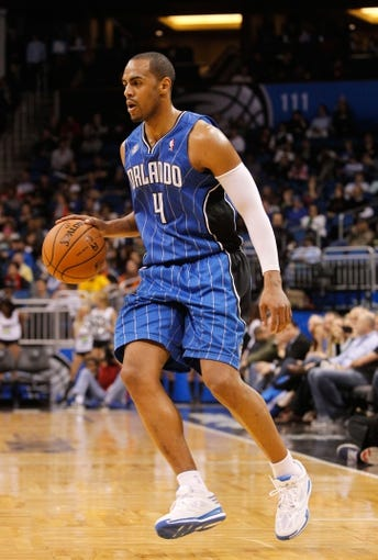 Jan 31, 2014; Orlando, FL, USA; Orlando Magic shooting guard Arron Afflalo (4) dribbles the ball against the Milwaukee Bucks during the second half at Amway Center. Orlando Magic defeated the Milwaukee Bucks 113-102.  Mandatory Credit: Kim Klement-USA TODAY Sports