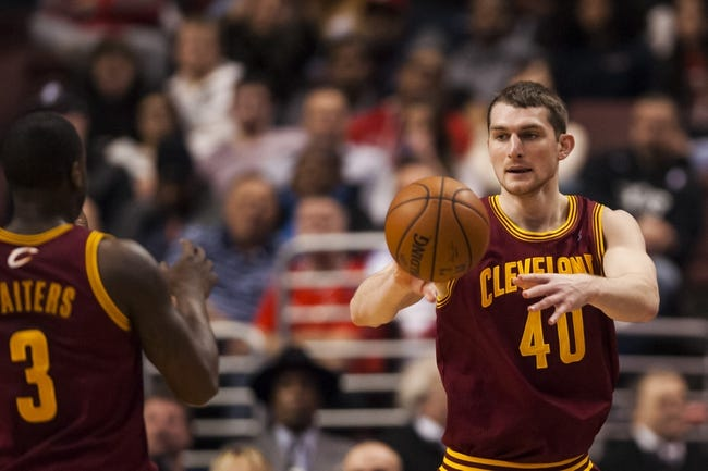 Feb 18, 2014; Philadelphia, PA, USA; Cleveland Cavaliers center Tyler Zeller (40) passes the ball to guard Dion Waiters (3) during the second quarter against the Philadelphia 76ers at the Wells Fargo Center. The Cavaliers defeated the Sixers 114-85. Mandatory Credit: Howard Smith-USA TODAY Sports