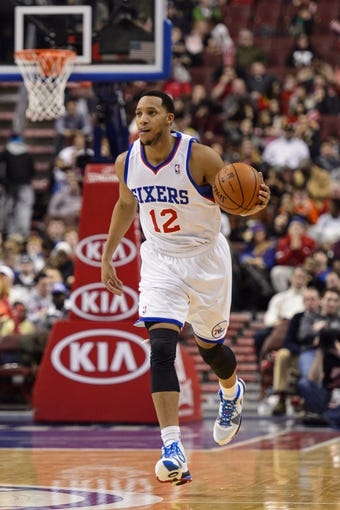 Feb 18, 2014; Philadelphia, PA, USA; Philadelphia 76ers guard Evan Turner (12) brings the ball up court during the third quarter against the Cleveland Cavaliers at the Wells Fargo Center. The Cavaliers defeated the Sixers 114-85. Mandatory Credit: Howard Smith-USA TODAY Sports