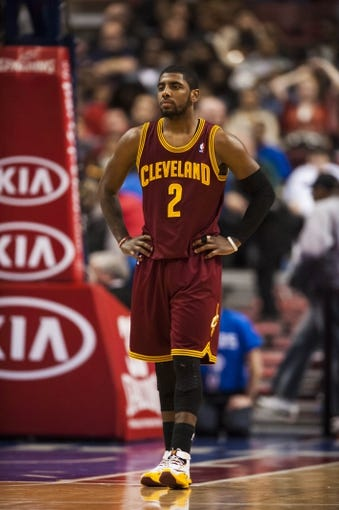Feb 18, 2014; Philadelphia, PA, USA; Cleveland Cavaliers guard Kyrie Irving (2) during the third quarter against the Philadelphia 76ers at the Wells Fargo Center. The Cavaliers defeated the Sixers 114-85. Mandatory Credit: Howard Smith-USA TODAY Sports