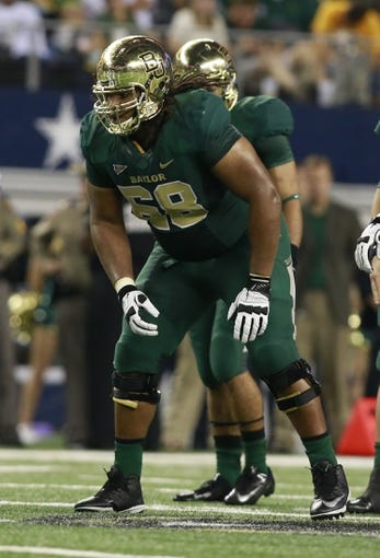 Nov 16, 2013; Arlington, TX, USA; Baylor Bears guard Cyril Richardson (68) in game action against the Texas Tech Red Raiders at AT&T Stadium. Mandatory Credit: Tim Heitman-USA TODAY Sports