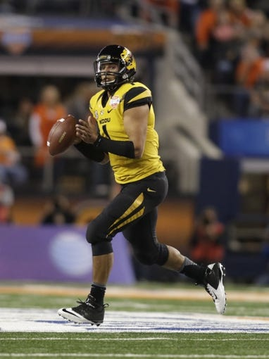 Jan 3, 2014; Arlington, TX, USA; Missouri Tigers quarterback James Franklin (1) scrambles in the pocket in the game against the Oklahoma State Cowboys at the 2014 Cotton Bowl at AT&T Stadium. Missouri beat Oklahoma State 41-31. Mandatory Credit: Tim Heitman-USA TODAY Sports
